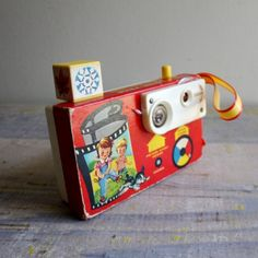 Vintage Fisher Price Camera - back view A perfectly analogue fisher price picture story camera. Viewfinder has a changeable color wheel for cool effects and pressing the 'shutter' button changes the scene which features animals, farm and nature scenes.