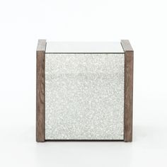 Rectangular, wire-brushed oak solidly frames the sparkle of antique mirrored tops and sides in simple, livable shapes.