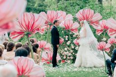 Giant painted flower ceremony decor. Gorgeous!