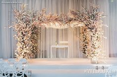 WedLuxe: all-white #ceremony #decor accented with a stunning chuppah composed of cherry blossoms - Photography: Mango Studios // Floral and Decor: Forget Me Not Flowers