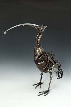 Fabulous sculptured bird made from recycled car parts... by James Corbettart