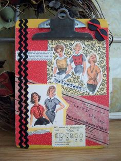 Altered clipboard art using vintage sewing pattern pieces. http://www.etsy.com/listing/84596932/altered-art-collage-clipboard-sewing