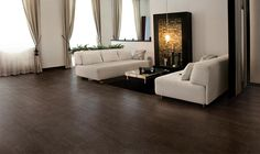 Hand scraped hardwood look #tile for contemporary living room. Riflessi di Legno in Ebony by Marazzi.