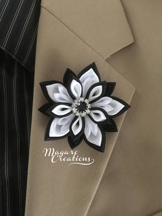 Mens lapel pin. The pin is made out of satin ribbons in the Japanese kanzashi technic. The flower measures approx. 2 3/4 across. The center of the flower is adorned with a high-quality rhinestone. This listing is for one lapel pin in BLACK/WHITE color combination. This beautiful