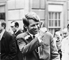 Senator Robert Kennedy gets a surprise  from his sister in law, Mrs. Jackie Kennedy, when she appears at a window when he was parading up Fifth Avenue in the 1966 St. Patrick's Day Parade.
