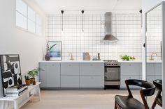 Grey kitchen with brass tapware
