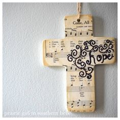 Ceramic cross, modge podge and cover with paper then use a sharpies to write a word and put details