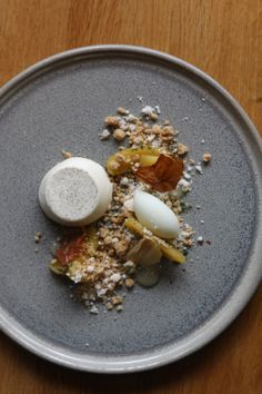 Mascarpone and cinnamon panncotta, caramel apples, milk tuile and brown butter powder.