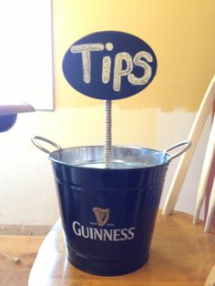 Creative way to turn a bucket into a tip jar for the bar.