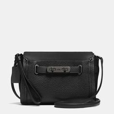 """The most iconic piece of Coach hardware is reimagined as an elongated, double-turnlock statement piece, giving our latest wristlet design a little bit of """"swagger."""" With the long detachable strap, it doubles as a crossbody bag."""