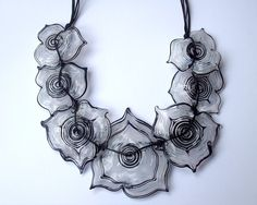 YasminSivan uses her incredible lampworked flower beads to create a timeless look