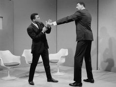 Basketball star Wilt Chamberlain extends a long left in the direction of world heavyweight champion Muhammad Ali as they meet at ABC's television studio in New York, March 10, 1967. Chamberlain stands 7 feet, 1 inch tall, and Ali is 6 feet, 2 inches tall. Chamberlain's reach is over 90 inches, Ali's is 79 inches. Their proposed fight, in all seriousness, never came off.