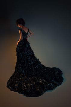 Trash bag evening gown. Had this been made in white, it might have passed for a wedding gown. I love the train...
