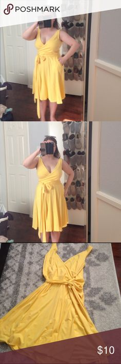 Yellow Jersey Wrap Dress Mods International, the Victoria Secret brand, had these amazing wrap dresses with real pockets! This one is very gently worn, and has no noticeable wear. A size small that rubs true to size, it no longer fits me. I wore it once to a Harry Potter party as my Hufflepuff outfit, but it now needs an owner who it fits better. This is a true wrap dress, can be undone to pay flat. No trades, offers welcome. Moda International Dresses
