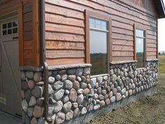 cedar siding with river rock homes