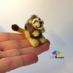 This brave little lion miniature is looking for a new home! I promise this little lion won't bite :D