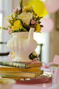 Vintage Tea Party - Tea pot on stack of old books as centrepiece