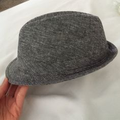 Urban Outfitters Women Fedora I bought this from Urban Outfitters a few years ago, it is a women fedora and has been worn once. The inside where my forehead would be has a little makeup rub off on it and the price is reflected upon that. Urban Outfitters Accessories Hats
