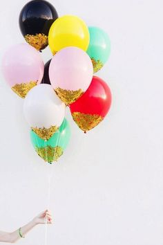 Use gold foil confetti and glue to make these party balloons.
