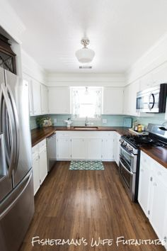 Beautiful small kitchen - tile and white cabinets with dark countertops and floors makes it seem much larger