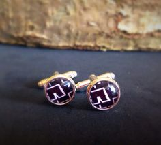 A personal favorite from my Etsy shop https://www.etsy.com/uk/listing/399164075/rammstein-band-rock-metal-cufflinks