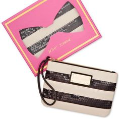 "Betsey Johnson Exclusive Boxed Sequin Wristlet Exclusive Boxed Sequin Wristlet by Betsey Johnson in black/cream color. The fabulous girl's going out bag. This sequin wristlet is just the thing to stash a few cards, cash, cellphone and lipgloss. From Betsey Johnson. Faux leather. Wrist strap with 5"" drop. Top zip closure. Exterior features gold-tone hardware and sequin detail. 7-1/2"" W x 5"" H x 1/2"" D. New with tags, unused. Betsey Johnson Bags Clutches & Wristlets"