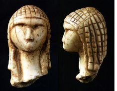 The Venus of Brassempouy is one of the earliest known realistic representations of a human face and hairstyle. It was carved from mammoth tusks approximately 27,000 years ago.