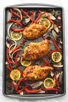Easy and healthy baked greek chicken & veggies sheet pan dinner is seasoned and cooked to flavorful perfection and couldn't be easier with just one pan and a handful of simple ingredients.  | lecremedelacrumb.com