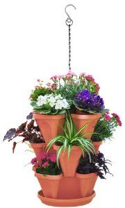 Stackable Planter, 3 Tier, Terracotta Color, Hanging Chain, Flowers, Greenery or Herb Garden. by Sana Enterprises. $17.95. Great for indoors, outdoors or the balcony. Easy to assemble.. Three tiers Stackable Planter creates an amazing display of greenery, flowers or an herb garden. Each basket provides you 4 planter pots. A total of 12 planting areas for the three tiers. Each clover shaped basket is about 6 inches High and 13 inches in Diameter.. Included in the set are 3 tiers ...