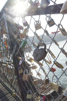 Lock Bridge in Paris! This is a bridge in Paris. You hang a lock with the name of you and your boyfriend/ girlfriend/ best-friend then you throw the key in the river. So even though the relationship may end you can't remove the lock. It stays there forever as relevance to someone once a part of your life. Definitely on my bucket list!!