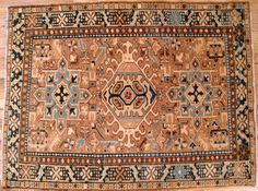 This handsome hand-woven geometric rug features multiple medallions in the softly hued sand-brown field. The central field is enclosed within a stylized structural outer border. The short wool pile is even throughout, and the rug is in excellent condition for its age and weaving style.   eBay!