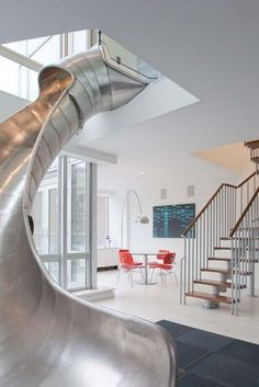 how much fun would it be to have a giant slide in your home?