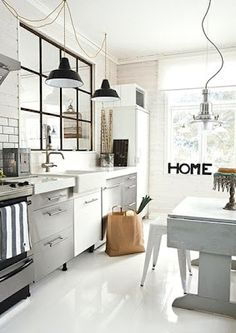 modern country. Love the internal window / mirror and the table. Interesting lights too