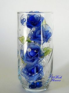 Items similar to Beautifully artificial blue rose are very lovely in the glass. Handmade nylon fabric arrangement flower and leaves. on Etsy Nylon Flowers, Silk Flowers, Fabric Flowers, Love Wishes, Wedding Napkins, Blue Roses, Very Lovely, Flower Arrangements, Projects To Try