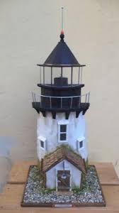 Imagen relacionada Garden Lighthouse, Clay Pot Lighthouse, Lighthouse Art, Garden Windmill, Pvc Pipe Crafts, Cinder Block Garden, Driftwood Projects, Stone Cottages, Owl House