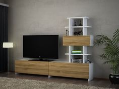 With the help of this unit, you can keep your television and other essentials. Get this DORIS White and Walnut TV Unit for only $459.06 on our website! Tags: #doseofmodern #homedecor #interior #decor #furniture #interiors #homedesign #decoration #instahome #instadesign #television #furnituredesign #tv #livingroom #trivia #interiordecor #interiorstyling #bedroom #instadecor #interiordesigner #homestyle #decorating #interior4all #interior123 #homesweethome #modern #woodworking #sofa Tv Unit Furniture, Modern Furniture, Furniture Design, Interior Styling, Interior Decorating, Interior Design, Dory, Trivia
