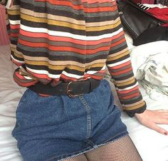 I like the top with jeans, but I am not sure about the jeans being a skirt and the fishnet pantyhose.