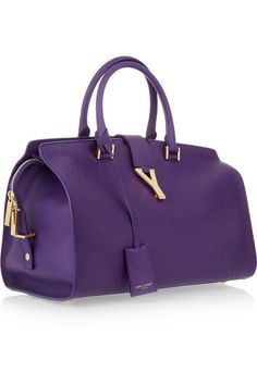 Purple leather (calf) Two top handles Detachable keyfob, gold hardware, feet Internal pouch pockets, zip-fastening pocket 'Y'-detailed snap-fastening tab and zip-fastening top  Comes with dust bag