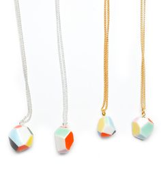 Hand formed and hand painted porcelain pendants.  No two are alike.  These gems are truly one of a kind!