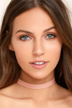 """No need to debate it, the Without a Doubt Pink Choker Necklace is the winner, hands down! Chic vegan leather choker with gold ends that fasten behind the neck. Necklace measures 11.5"""" around, plus a 4"""" extender chain."""