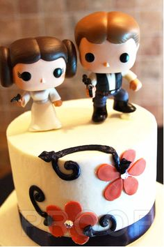 Need an affordable way to find super geeky wedding cake toppers - get plastic bobble head dolls of your favorite geeky couple!