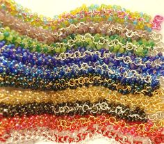 """Shaggy Beaded Bracelets are so much fun to make! They are not hard, but do require a bit of time, 2-3 hours. You need about 200 beads to make a bracelet. You can start with a pile of jump rings to make the """"stem"""" in a 1-into-1 chain, or start with a ready made chain. Attach 2 jump rings to each """"stem"""" link and 2 beads to each loose jump ring. This will make a nice full """"shag"""". Charms can also be added with jump rings. Beads can be added with head pins or eye pins. Finish with a clasp!"""