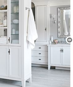 Unfitted cool  Cabinetry with legs gives the feel of stand-alone furniture.