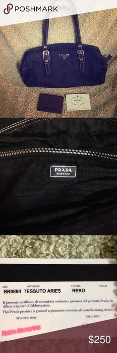 Authentic Prada bag dust cover not included Authentic Vintage Prada Bag w/ authenticity certificate card ...please notice the seam on the inside of this bag was repaired....dust cover not included Prada Bags Shoulder Bags