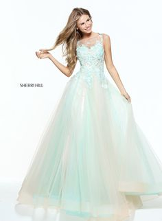 Two-toned tulle with beaded floral appliques style this Sherri Hill 51051 prom dress, with a high square neckline, illusion back and horsehair hem. 3D florettes embellish the sweetheart-lined bodice and stream toward the topskirt, vamping up this pastel-colored A-line dress.