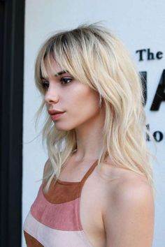 """Layered shag with wispy bangs that are tapered and thicker on the sides. Load up with salt spray. """"An ocean mist will bring out the natural texture of the haircut,""""... """"Spray hair while damp or dry, flip hair upside-down, and scrunch. This gives the hair lots of body and texture."""""""
