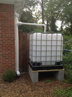 275 gallon IBC container with single tube first flush rain water capturing set up.