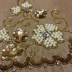 Beautifully embroidered floral motif with beading and sequins. www.handembroidery.com