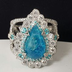 "Pear shape monster sized Paraiba Tourmaline set in Erica 's ""Empress"" ring design"
