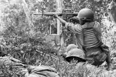 ARVN (Army of Republic of Viet Nam) soldier using spray and pray counter fire as taught by the US Army while others just praying and keeping their heads down.
